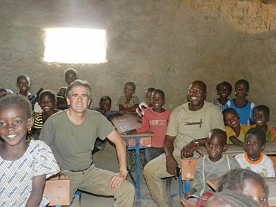 Image of Caravan to Class founder and director Barry Hoffner in one of the organizeation-funded classrooms with students