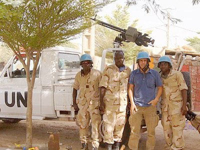Image of Caravan to Class founder and director Barry Hoffner with a group of armed United Nations Peacekeepers