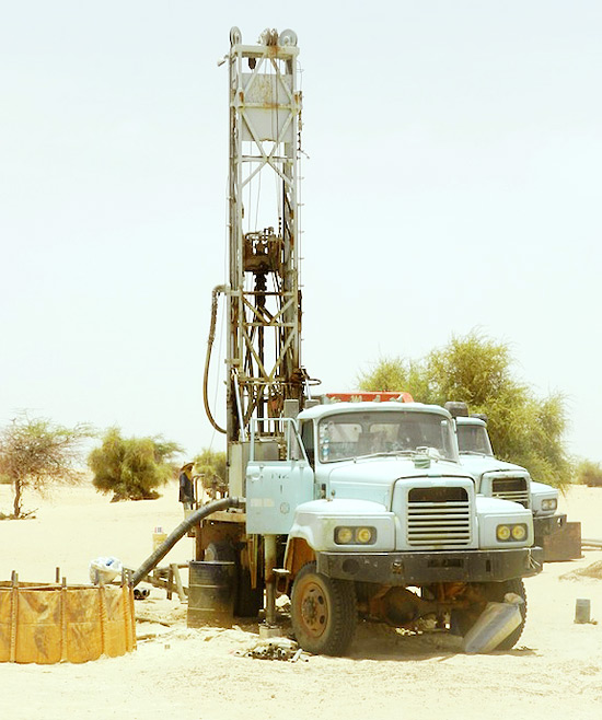 Image of a drilling rig from German NGO Arche Nova preparing a well at a schools in the village of Tourari