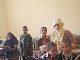 Director Hoffner with students in a classroom at the school in Teshaq rehabilitated by Caravan to Class