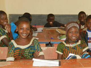 Students in a classroom at the school in Koriome supported by Caravan to Class
