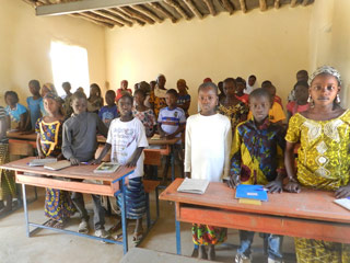 A group of students in a classroom at the school in Koriome supported by Caravan to Class