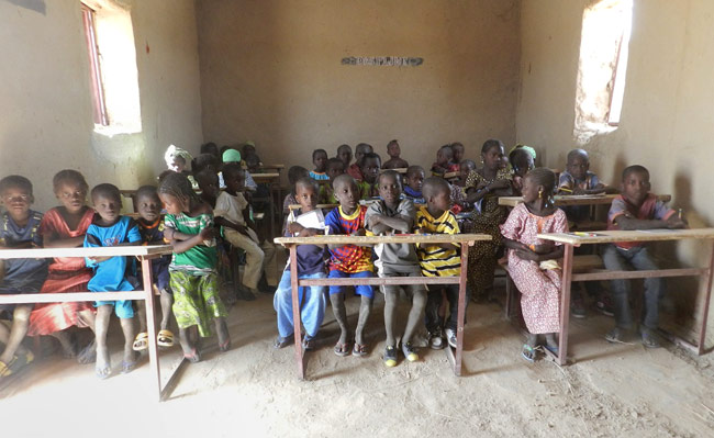 A classroom of students in their school in Togha built by Caravan to Class
